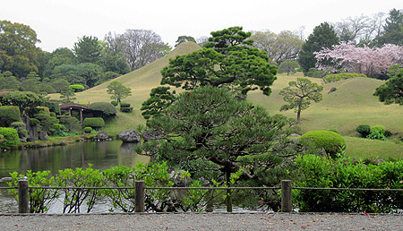 Suizen-ji Jōju-en, a garden in Kumamoto, with an earthen sculpture of Mount Fuji.